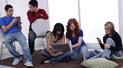 Group of teens using technology - stock footage
