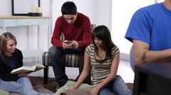 Group of teens hanging out together Stock Footage