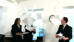 Happy businesspeople throwing papers, slow motion Stock Footage