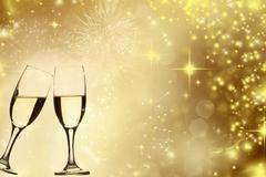 Glasses of champagne against holiday lights Stock Photos