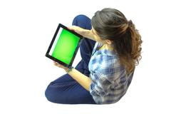 using a tablet - stock photo