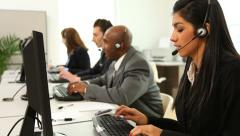 Group of customer service people at computers - stock footage