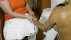 Young pregnant woman receiving relaxing prenatal massage Stock Footage