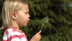 Young girl making a wish, slow motion Stock Footage