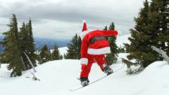Snowboarding Santa Claus crashes - stock footage