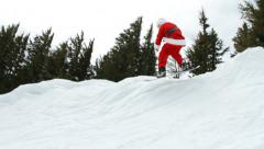 Stock Video Footage of Santa Claus snowboarding