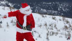 Santa Claus snowboarding - stock footage
