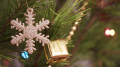 decorative snowflake on christmas tree decorated with flashing garlands - stock footage