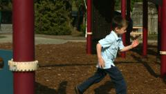 Kids running in the playground, slow motion Stock Footage