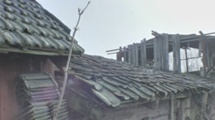 Roof Tiles of an Old Abanonded shed that is Slowly Falling Apart - 29,97FPS NTSC Stock Footage