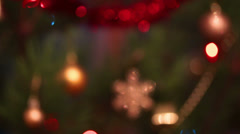 Defocused decorated christmas tree with flashing garlands Stock Footage