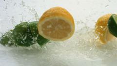 Lemon and lime splashing, slow motion - stock footage