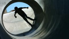 Skateboarder rides a full pipe, slow motion Stock Footage