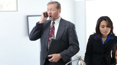 Three business people having disscussion - stock footage