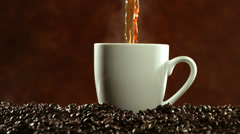 Coffee pouring and steaming, slow motion Stock Footage