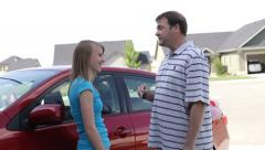 Father gives car keys to daughter - stock footage