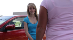 Teenage girl gets into car for her first drive Stock Footage