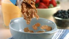 Pouring cereal into bowl, slow motion - stock footage