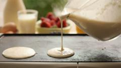 Pouring pancake batter - stock footage