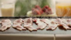 Bacon cooking on grill - stock footage