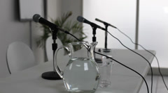 Microphones at table, dolly Stock Footage