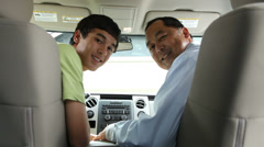 Father and son in truck look back Stock Footage