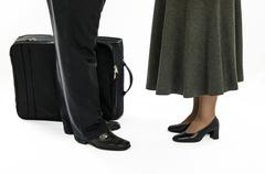 man and a woman saying goodbye - stock photo