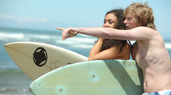 Portrait of couple at beach with surfboards - stock footage