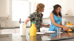 Couple preparing breakfast together Stock Footage