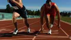 Track runners at starting line, slow motion Stock Footage