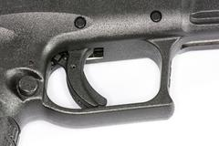 trigger of hand gun on white background - stock photo