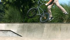 BMX rider doing a tail whip, slow motion Stock Footage