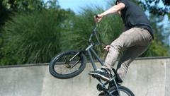 BMX rider doing a 360 air, slow motion - stock footage