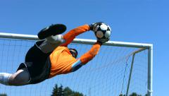 Soccer goalie makes a save, slow motion Stock Footage