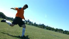 Soccer goalie kicks ball, slow motion - stock footage