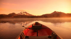 Canoe on misty lake at sunrise - stock footage