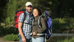 Portrait of couple with backpacks Stock Footage
