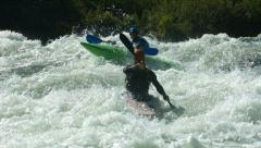 Kayaking in white water, super slow motion Stock Footage