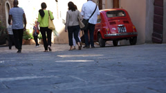 People walking down an a street in Tuscany Stock Footage