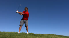 Golfer hits ball, slow motion Stock Footage
