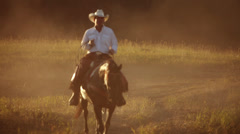 Portrait of cowboy on his horse - stock footage