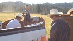 Cowboys take break from herding cattle - stock footage