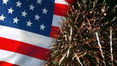 Fourth of July Fireworks show and waving US flag - stock footage