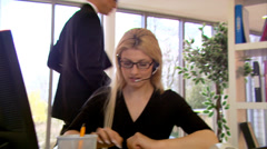 Attractive female customer service operator at work. High quality HD video Stock Footage