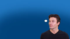 Man on blue background with thought bubble, left blank for copy space. High Stock Footage