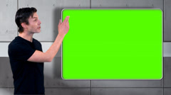 Television presenter or weatherman does piece to camera with greenscreen Stock Footage