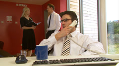 Steadycam motion tracks with tired businessman who takes a break for a sip of - stock footage