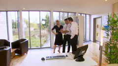 Business team collaborating together in a beautiful modern office which is set - stock footage