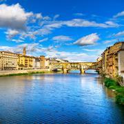 Ponte vecchio landmark on sunset, old bridge, arno river in florence. tuscany Stock Photos