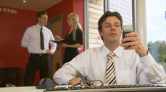Businessman makes a phone call at his desk. High quality HD video footage Stock Footage